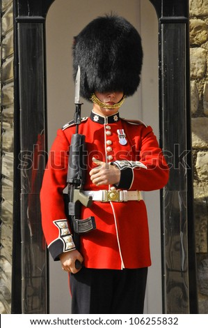 LONDON - ENGLAND JUNE 02:Queen's Guard - Tower of London on June 02 2012. The Queen's Guard is the contingents of infantry and cavalry soldiers charged with guarding the official royal residences. - stock photo