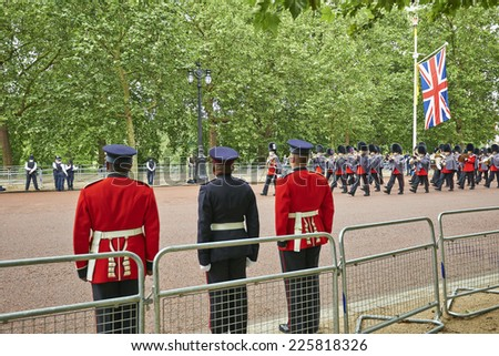 LONDON, ENGLAND - June 07, 2014: Rescue officers on Guard near Buckingham Palace, London for Trooping the Colour in London, England the 07 june 2014 - stock photo