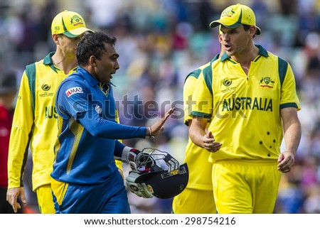 LONDON, ENGLAND - June 17 2013:  Sri Lanka's Mahela Jayawardene and Australia's Clint McKay exchange words during the ICC Champions Trophy international cricket match between Sri Lanka and Australia.