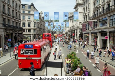 LONDON, ENGLAND - JUNE 22, 2014: View from the top of a double decker bus of the cavalcade of buses along Regent Street, Westminster, celebrating the bicentenary of London buses.   - stock photo