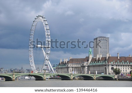 LONDON ENGLAND JUNE 1:  View of the River Thames in London showing the London Eye, Westminster Bridge and City Hall on june 1 2012 in London England - stock photo