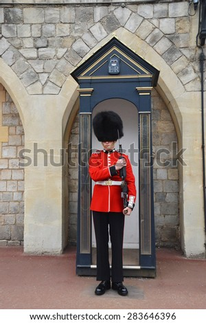 LONDON - ENGLAND JUNE 02 2015 : windsor castle -  The Queen's Guard is the contingents of infantry and cavalry soldiers charged with guarding the official royal residences.