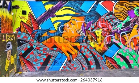 LONDON, ENGLAND -12 MARCH 2015- Editorial: Painted walls and graffiti art are scattered in the Brick Lane and Shoreditch area in East London in the heart of Banglatown. - stock photo