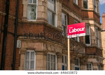London, England - May 2017:A Vote Labour Sign poster with victorian houses in the background on a local street in London supporting the labour party for the next General Election