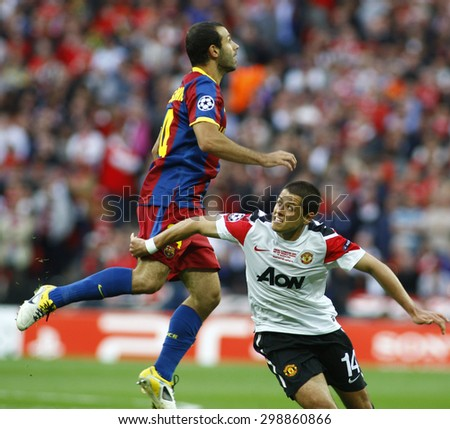 LONDON, ENGLAND. May 28 2011: Barcelona's midfielder Javier Mascherano and Manchester's forward Javier Hernandez during the 2011UEFA Champions League final between Manchester United and FC Barcelona - stock photo