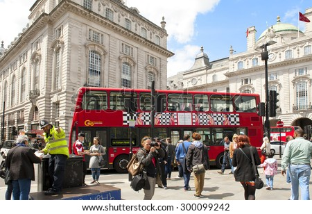 LONDON, ENGLAND - MAY 30: Double-decker bus at the Piccadilly Circus on May 30, 2015 in London - stock photo
