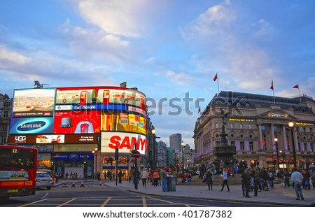 LONDON, ENGLAND - MAY 1, 2011: Illuminated Piccadilly Circus at night in London. It os a road and public space in City of Westminster in London in England. The street view with tourists.