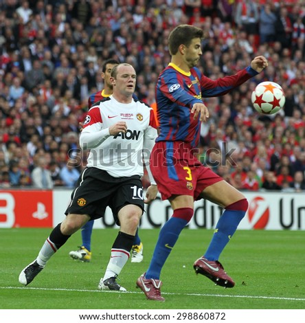 LONDON, ENGLAND. May 28 2011: Manchester's forward Wayne Rooney and Barcelona's defender Gerard Pique during the 2011UEFA Champions League final between Manchester United and FC Barcelona - stock photo