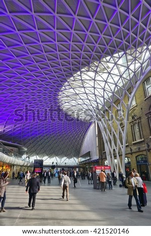 LONDON, ENGLAND -14 MAY 2016- The Kings Cross train Station in central London.Virgin Trains is the main operator out of this railway station. - stock photo