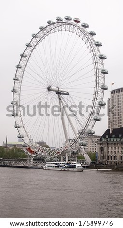 LONDON, ENGLAND - MAY 20 2013: The London Eye is a giant Ferris wheel on the South Bank of the River Thames in London. Also known as the Millennium Wheel - stock photo
