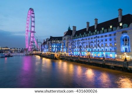 LONDON, ENGLAND - May 28, 2016 : The London Eye near the River Thames in London at dusk, England. The London Eye is a giant Ferris wheel on the South Bank of the River Thames in London - stock photo