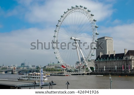 LONDON, ENGLAND - MAY 3, 2007: View at London Eye ferris wheel in London, England. Wheel haveheight of 135m and was completed at March 2000.