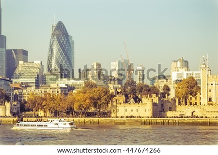 LONDON, ENGLAND - NOVEMBER 01, 2015. The City in a bright sunny day at sunset while walking people look with expectation. This district is the the European Union's financial and trade center.    - stock photo