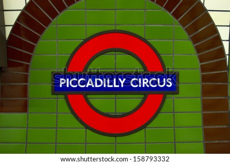 LONDON, ENGLAND - OCT 09: Underground Piccadilly Circus tube station in London on October 09, 2013. The London Underground is the oldest underground railway in the world covering 402 km of tracks. - stock photo