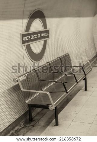 LONDON, ENGLAND - SEP 30: Underground Kings Cross tube station in London on September 30, 2012. The London Underground is the oldest underground railway in the world covering 402 km of tracks - stock photo