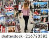 London, England - Sept 11th, 2014: Pedestrians moving along a busy street in London as viewed between two display stands of postcards depicting scenes of London and the British Royal Family - stock photo