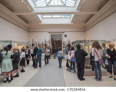 LONDON, ENGLAND, UK - JUNE 17, 2011: Tourists visiting the Egyptian rooms at the British Museum