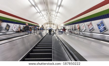LONDON, ENGLAND, UK - May 22, 2013: Escalators transporting commuters at the London public metro system.