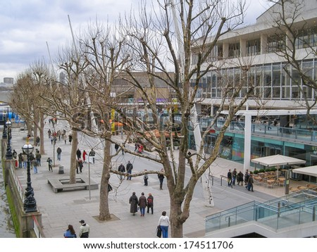 LONDON, ENGLAND, UK - OCTOBER 01, 2006: Tourists on the South Bank in front of the Royal Festival Hall built during the Festival of Britain celebrations in 1951 and still in use as a major music venue - stock photo