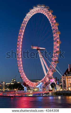 London Eye at the evening in London with reflection on water. Motion - stock photo