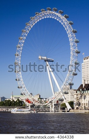 London Eye with Thames River. Lots of blue and blue sky - stock photo