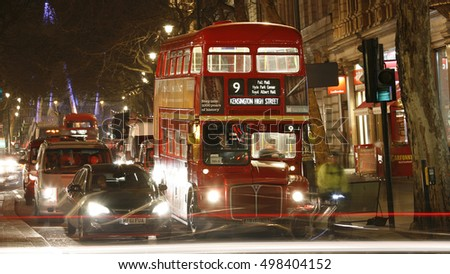 LONDON - FEB 19: Heritage Routemaster Bus operated in London from 1956 to 2005; at night on Feb 19; 2013 in London; UK. The open platform allowed minimal boarding time and optimal security.