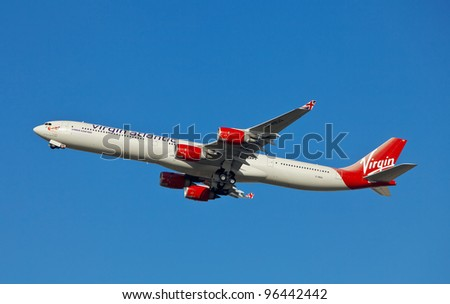 LONDON - FEBRUARY 19: A Virgin Atlantic Airbus A340 leaves Heathrow on route to the US on February 19, 2012 in London, England. Virgin's operating bases are London Heathrow & Gatwick with a fleet of 35 aircraft - stock photo