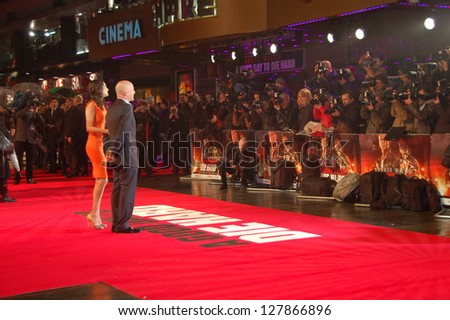 LONDON -  FEBRUARY 7:  Actor Bruce Willis and his wife, Emma Heming-Willis are posing on the Red Carpet Premiere of A Good Day To Die Hard in London, UK on Thursday,  February 7, 2013.