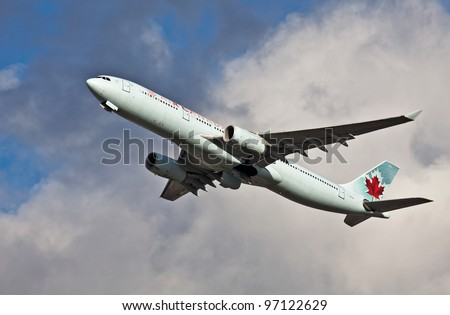 LONDON - FEBRUARY 19: Canadian Airlines Airbus A330 leaves Heathrow on route to Canada on February 19, 2012 at London. As of Nov 2011, 828 A330's units had been built. Cost per unit averages US$205 Mn - stock photo