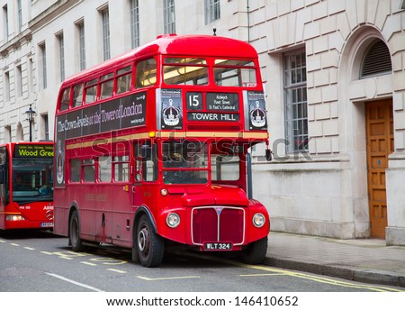 LONDON - FEBRUARY 13: Red Double Decker Bus on the Trafalgar square in London on Febuary 13, 2010 in London, UK. These dobledecker bus is one of the most iconic symbol of London. - stock photo