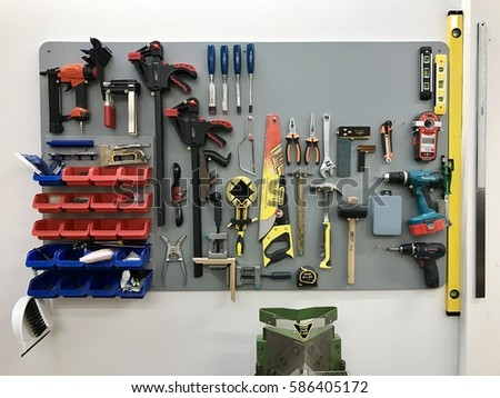 LONDON - FEBRUARY 19, 2017: Woodwork tools neatly organised on a wall inside a workshop in London, UK.