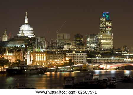 London Financial District at night. Office blocks and River Thames. - stock photo