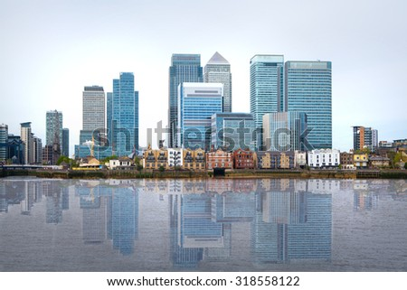 London, financial hub Canary Wharf view and river Thames - stock photo