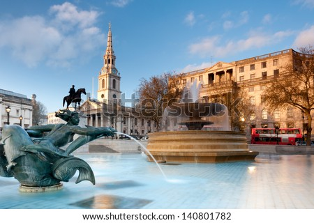 London, fountain on the Trafalgar Square with St. Martin on Fields behind - stock photo