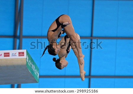 LONDON, GREAT BRITAIN - APRIL 25 2015: Jennifer Abel and Pamela Ware of Canada competing in the women's synchro 10m platform during the FINA/NVC Diving World Series at the London Aquatics Centre - stock photo