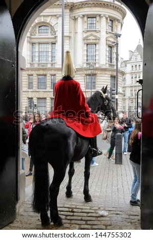 LONDON, GREATER LONDON, ENGLAND - July 14: A mounted trooper of the Household Cavalry guarding the entrance to Horse Guards on July 14, 2012 in London, Greater London, England.