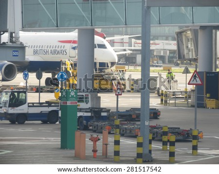 LONDON HEATHROW, UK - CIRCA DECEMBER 2014: London Heathrow airport is one of the busier airports in the world, with thousands of passengers every day - stock photo