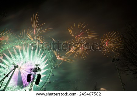 LONDON - JANUARY 01, 2015: A spectacular firework display in Westminster celebrating the New Year, January 01, 2015 in London, England. - stock photo