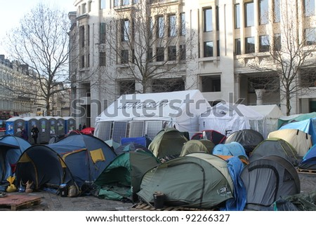 LONDON - JANUARY 5: Anti-Capitalist demonstrators protest and camp at St. Pauls Cathedral in London, England on January 5, 2012 - stock photo