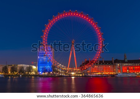 LONDON - JANUARY 16, 2016: Night shot of the London Eye. The London Eye is a giant Ferris wheel on the South Bank of the River Thames and offers a great viewing point over central London - stock photo