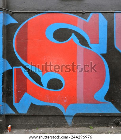 LONDON - JANUARY 11. Painted letter by Portugese artist Oker on January 11, 2015, at Ebor Street, Shoreditch in the Borough of Tower Hamlets, an area renown for its street art in east London, UK. - stock photo