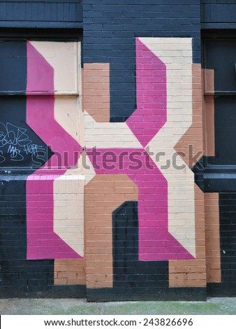 LONDON - JANUARY 11. Street painting on old brick building by Ben Eine on January 11, 2015, at Ebor Street, Shoreditch in the Borough of Tower Hamlets, an area renown for its street art in London. - stock photo