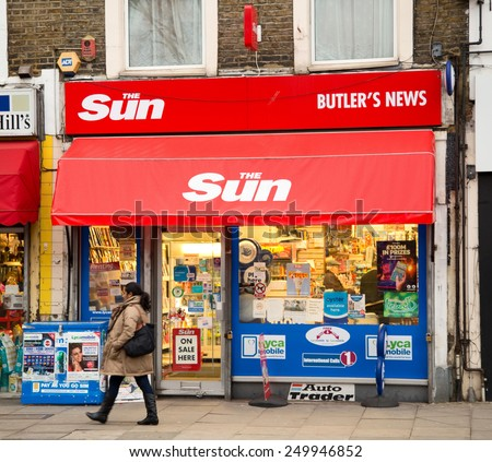 LONDON - JANUARY 27TH: The exterior of the Sun newsagent on January the 27th, 2015, in London, England, UK. The sun is the UK's top selling newspaper.  - stock photo