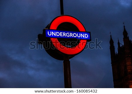 LONDON JANUARY 01: Traditional station sign for the London Underground transportation systems at night on January 01, 2013 in London, UK. The sign was first used in 1908. - stock photo