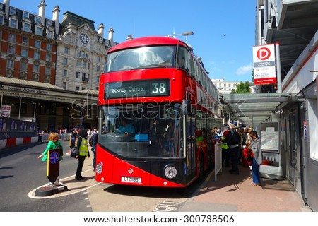 LONDON - JULY 26: A London bus at Victoria Station, London. London buses are increasingly fuel efficient. July 26, 2015 in London. - stock photo