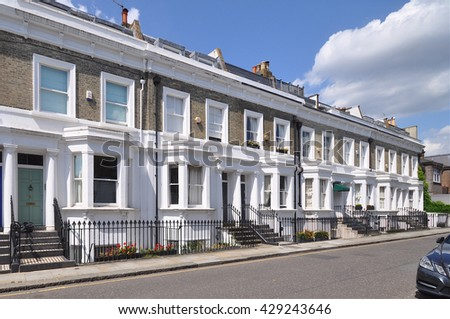 LONDON - JULY 1, 2014. A terrace of fine 19th century English Victorian period town houses in Shawfield Street, Chelsea, London, UK. - stock photo