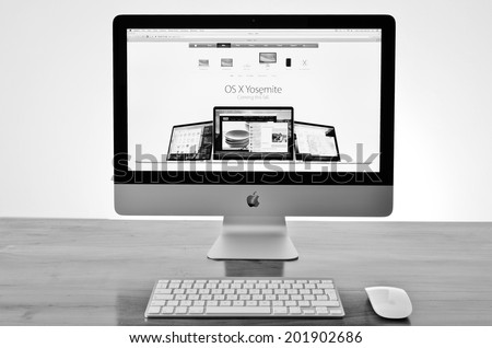 LONDON - JULY 01: APPLE iMac with new Yosemite osx software launch details on screen. July 01, 2014 in London, UK. - stock photo