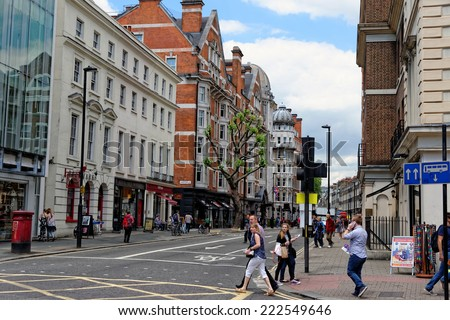 LONDON - JULY 1, 2014: Bloomsbery street in central London in Bloomsbury area. It was developed by the Russell family in the 17th and 18th centuries into a fashionable residential area.  - stock photo