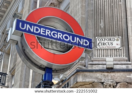 LONDON - JULY 1, 2014: London underground sign at Oxford Circus Station, with the focus on the Oxford Circus sign. - stock photo