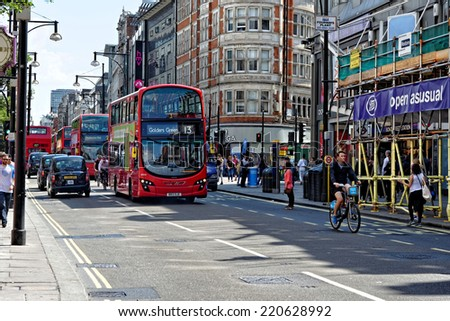 LONDON - JULY 1, 2014: Red double decker buses in Oxford Street. This buses have become an icon of Britain and are a major tourist attraction in themselves.
